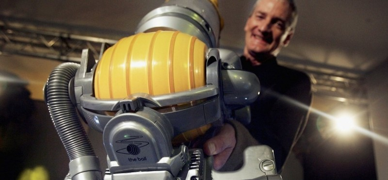 James Dyson with one of his vacum cleaners