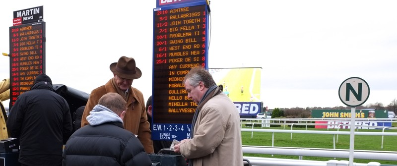 Bookies taking bets at a horse race