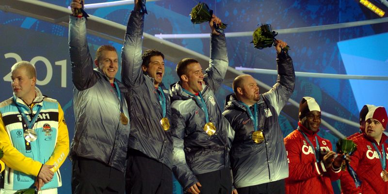 Team celebrating on podium