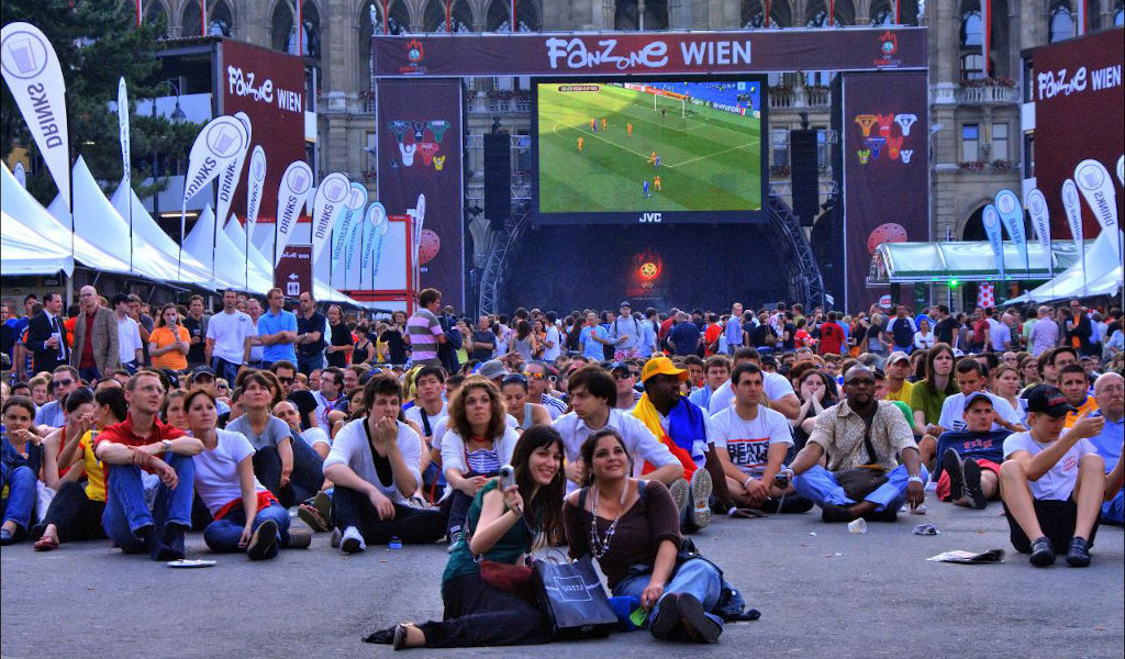Fans watching football on the big screen at a fanzone