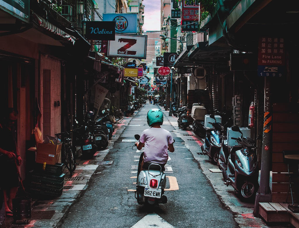 Scooter ride in street in Tawian